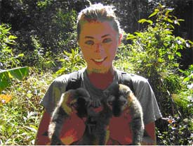 Kira Delmore with 2 Red Fronted Lemurs